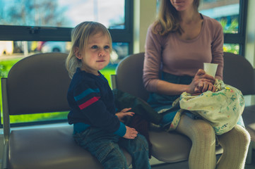 Mother and toddler in waiting room