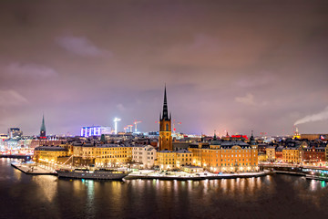 Wall Mural - View of Stockholm city at night in winter time.