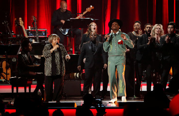Mavis Staples, Leon Bridges and Jon Batiste perform during a gala event honoring Dolly Parton as the MusiCares person of the year in Los Angeles