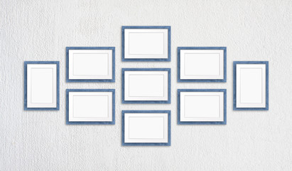 Blank frames collage, nine blue realistic wooden frameworks isolated on white plastered wall