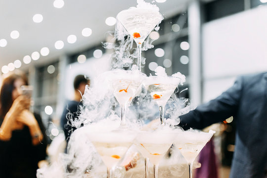 pyramid of martini glasses with dry ice