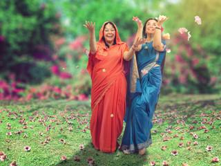 Traditional Indian dance of two Caucasian women in sari