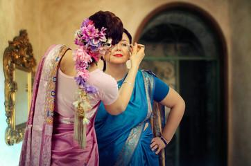 Two Caucasian women are Bharatanatyam dancers