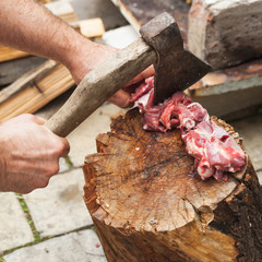 Raw lamb meat cutting on log, cook hands