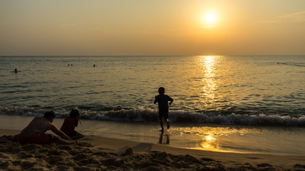 Children playing on the beach at the beautiful sunset ,beach activity in Vietnam