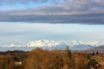 Winter panorama between Cassacco and Tricesimo. From the hills to the snow-capped mountains. Sunrise