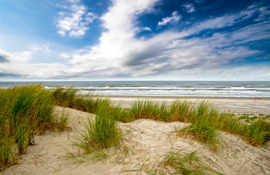Dune beach on the North Sea island Langeoog in Germany with clouds on a beautiful summer day, holidays in Europe