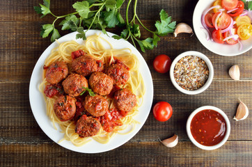 Meatballs and spaghetti on white plate