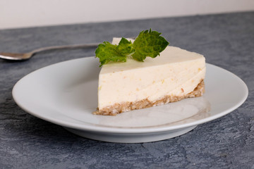 Slice of Plain New York Cheesecake on white plate