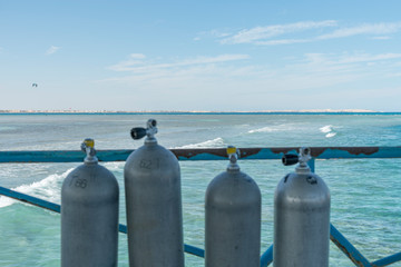A lot of diving cylinders. oxygen cylinders outdoor. Oxygen cylinders for swimming in the background of the sea. Wall mural