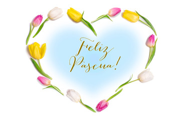 "Easter greeting card with pastel colored tulip flowers garland in heart form isolated on white background with Spanish text ""JFeliz Pascua"" (Translation: Happy Easter)"