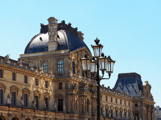 Palais du Louvre. Sunny glares from the fountain on the walls of the Palace