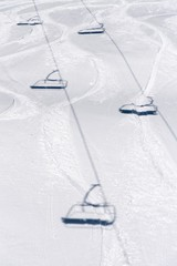 Shadow of Cable cars on white ski slope