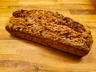A homemade bread loaf on a wooden table