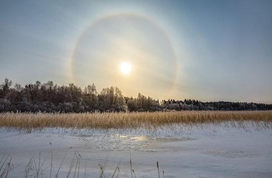 Solar halo. Frosty day, heavenly rainbow. Winter phenomenon.
