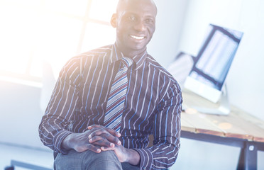 Portrait of an handsome black businessman sitting in office