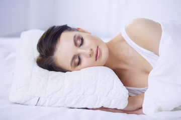 Young beautiful woman lying in bed.