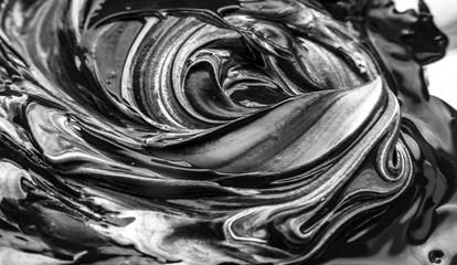 Abstract black and white artwork as a result of mixing paint