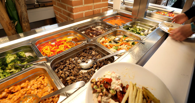 self service restaurant with many raw and cooked foods