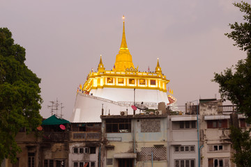 View of the chedi of the Temple of the Golden Mountain (Wat Saket) in the evening twilight. Bangkok, Thailand