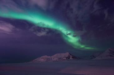 Foto auf Leinwand Violett The polar arctic Northern lights aurora borealis sky star in Norway travel Svalbard in Longyearbyen city the moon mountains