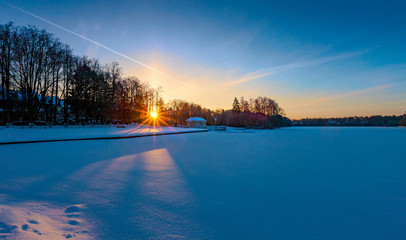 Winter sunrise over a snow-covered lake