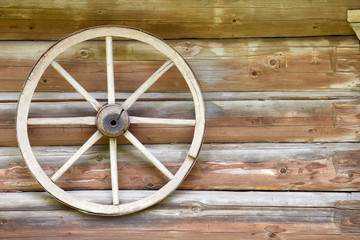 Background with a tree and a wheel. Russia . village