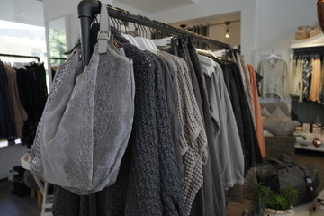 close up of grey modern women clothes on hanger in store