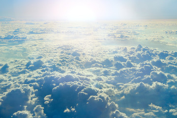 white clouds with sunny rays. Landscape with sun and sky