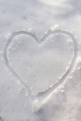 Heart on the snow background