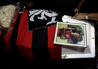 A picture of soccer player Vinicius de Barros Silva Freitas is seen on the coffin during his funeral service after a deadly fire at Flamengo soccer club's training center, in Volta Redonda