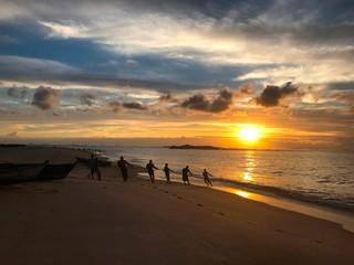 Fishing in sunrise