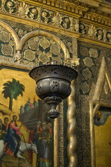icon lamp and floral ornaments on the interior walls of Saint Basil's Cathedral, the world famous orthodox church in the Red Square, a museum where it's allowed to take pictures