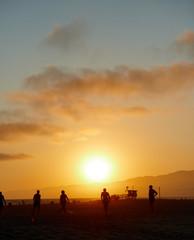 People on Los Angeles Santa Monica beach during sunset