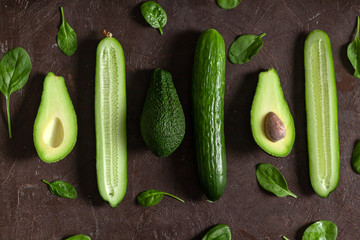 Creative fruit and vegetable pattern. Avocado, cucumber, spinach.