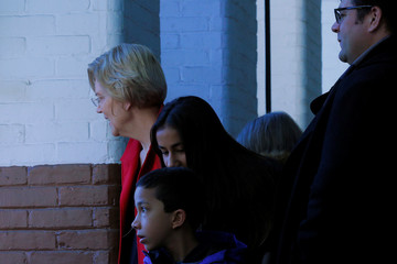 U.S. Senator Elizabeth Warren and her family look out over a rally to launch her campaign for the 2020 Democratic presidential nomination in Lawrence
