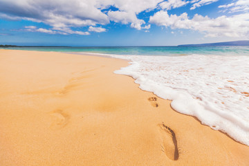 Beach footprint in sand nature landscape holiday background of footprints washed away by sea waves for travel vacation concept - footsteps in sand on summer tropical getaway holidays with blue ocean.