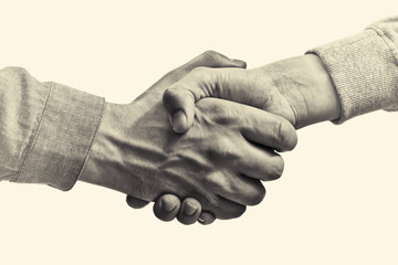 A firm handshake between two partners. Black and white image on isolated background.