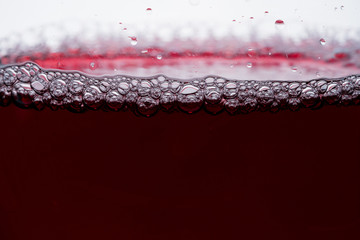 wine in glass on white background