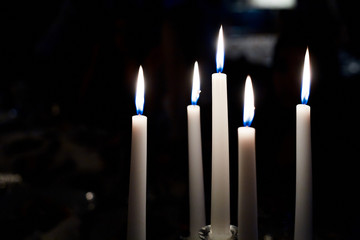 White candles in the darkness