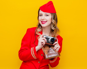 stewardess wearing in red uniform with photo camera