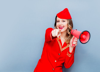 stewardess wearing in red uniform with megaphone