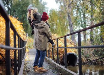 Two young travel couple walking on bridge