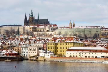 Snowy Prague Lesser Town with Prague Castle above River Vltava, Czech republic