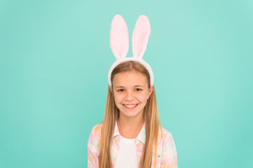Spring has sprung. Fashion accessory for easter costume party. Cute little girl wearing bunny ears headband. Small girl child in easter bunny style. Looking pretty in easter bunny attire