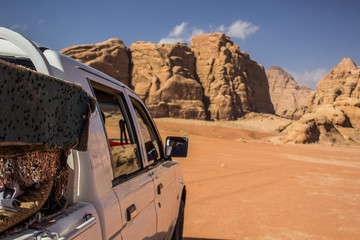 rally car in desert nature scenic landscape place somewhere in Middle East with steep mountain rocks background