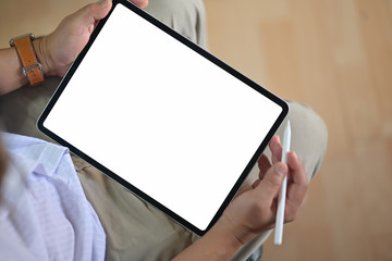 Closeup of male hands holding blank screen modern drawing tablet