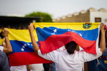 Lima, Lima / Peru - February 2 2019: People holding Venezuelan flag protesting against Nicolas Maduro
