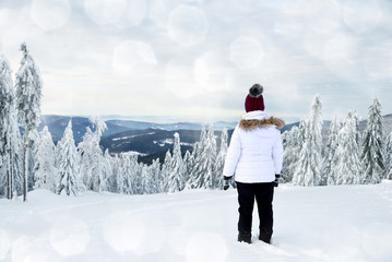 Woman in snowy winter landscape. National park Sumava in Czech Republic.
