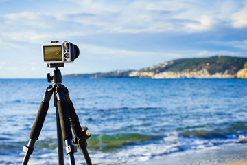 Camera taking picture film of sea coast